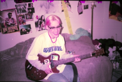 Julie playing my guitar in my old, old, old, old bedroom