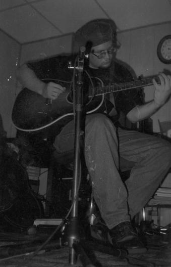 Playing guitar, around 1997